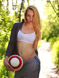 Young sporty woman with soccer ball Royalty Free Stock Image