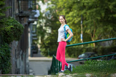 Young sporty woman standing outdoors after a workout in summer day. Stock Photos