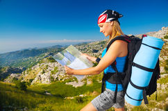 Woman on the mountain watching in map Royalty Free Stock Image