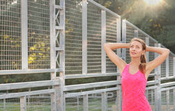 Young sporty woman stretching arms royalty free stock photography
