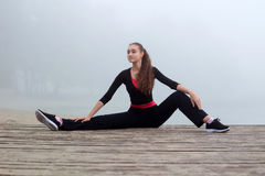 Young sporty woman stretching during fitness workout outdoor Royalty Free Stock Photography