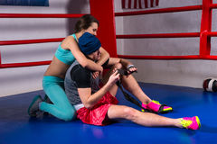 Young sporty woman support and hug male boxer in a boxing ring royalty free stock photos