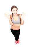 Young sporty woman surprised expression looking at camera Stock Photos