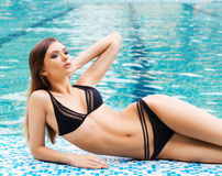 Young and sporty woman in a swimsuit Stock Image