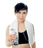 Young sporty woman with towel isolated royalty free stock photo