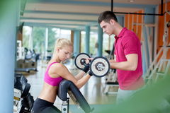 Young sporty woman with trainer exercise weights lifting Stock Photo