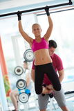 Young sporty woman with trainer exercise weights lifting Stock Image
