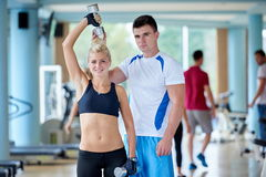 Young sporty woman with trainer exercise weights lifting Stock Photos