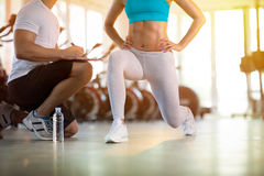 Young sporty woman with trainer exercise. Young sporty women with trainer exercise in fitness gym Royalty Free Stock Image