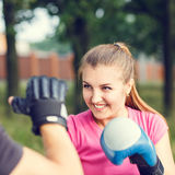 Young sporty woman training boxing with trainer Stock Images