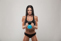 Young sporty woman training with the dumbbell Stock Image