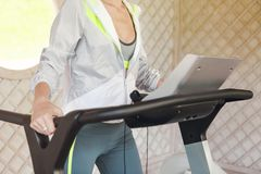 Young sporty woman on treadmill Royalty Free Stock Images