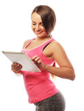 Young sporty woman using a digital tablet Royalty Free Stock Image