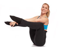 Young sporty woman in the warm-up workout. Sporty woman in the warm-up workout stock photography