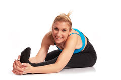 Young sporty woman in the warm-up workout. Sporty woman in the warm-up workout stock images