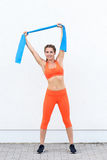 Young sporty woman working out with latex bands Stock Photo