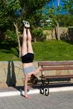 Woman working out in the park. Young sporty woman working out at the park Royalty Free Stock Photo