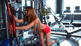 Young sporty women doing exercises in the gym centre stock video footage