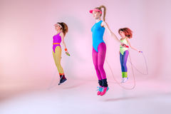 Young sporty women jumping with skipping ropes Royalty Free Stock Photo