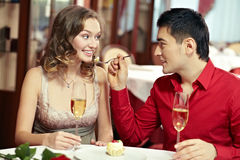 Young spouses dining out. Young couple dining out at restaurant Royalty Free Stock Photo