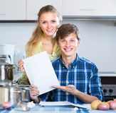 Young spouses filling forms for investment papers Stock Image