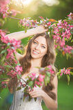 Young spring fashion woman in spring garden Springtime Summertim Royalty Free Stock Photo