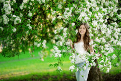 Young spring fashion woman in spring garden Springtime Summertim Stock Photo