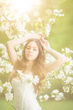 Young spring fashion woman in spring garden Springtime Summertim Stock Photography