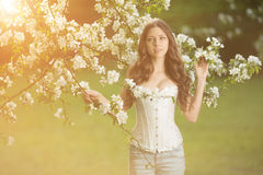 Young spring fashion woman in spring garden Springtime Summertim Stock Images
