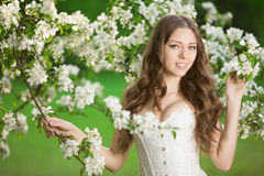 Young spring fashion woman in spring garden Springtime Summertim Royalty Free Stock Photography