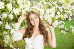 Young spring fashion woman in spring garden Springtime Summertim Royalty Free Stock Image