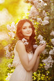Young spring fashion woman  in spring garden. Springtime. Trendy Royalty Free Stock Image