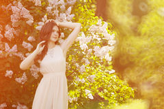 Young spring fashion woman  in spring garden. Springtime. Trendy Royalty Free Stock Photos