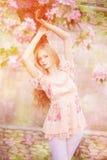Young spring fashion woman  in spring garden. Springtime. Trendy Stock Photos