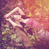 Young spring fashion woman  in spring garden. Springtime. Trendy Royalty Free Stock Photography
