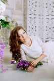 Young spring fashion woman in spring lux vintage interior. Sprin. Gtime. Trendy girl on a luxury spring background. Allergic to pollen of flowers. Spring allergy Stock Image