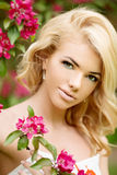 мYoung spring fashion woman. Trendy girl in the flowering trees Royalty Free Stock Image