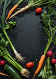 Young spring vegetables on black chalkboard from above Stock Image