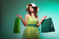 Young spring woman with shopping bag Stock Images