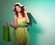 Young spring woman with shopping bag Royalty Free Stock Photos
