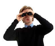 Young  spy man looking through binoculars Stock Photos