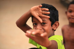 Young Sri Lankan boy playing for the camera Stock Photo