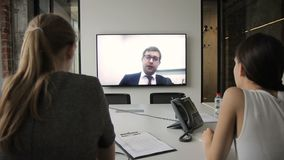 Young staff is at online conference in modern office. stock footage