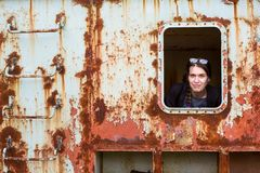 Young woman in an abandoned wagon train. Young stalker woman in an abandoned wagon train Royalty Free Stock Photography