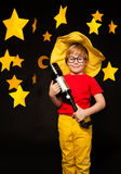 Young stargazer with telescope against starry sky Royalty Free Stock Photos