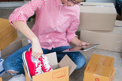 Start up small business owner packing shoes in the box at workpl Royalty Free Stock Images