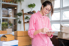 Start up small business owner working with digital tablet at wor Stock Photo