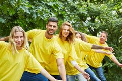 Young start-up team enjoys team training stock images