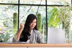 Start up woman raise fist with yes gesture at office. freelance Royalty Free Stock Images