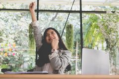 Start up woman raise fist with yes gesture at office. freelance Stock Image